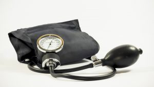 A blood pressure cuff representing Essential Hypertension's effect on blood pressure.