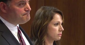 Rebecca Bredow and her lawyer Steven Vitale stand side-by-side in the courtroom as they await the Judge's ruling.