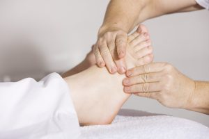 The joints in a foot are massaged by a holistic chiropractor to allow nerves to work at their optimum ability.